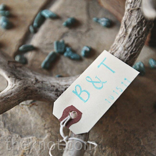 Antlers with scattered turquoise stones and tagged with the couple's initials tied in the rustic feel of the venue.