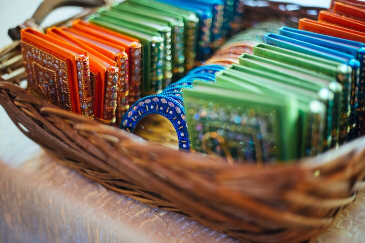 A basket of colorful beaded mirrors and tiny books and pens were given to guests as favors.