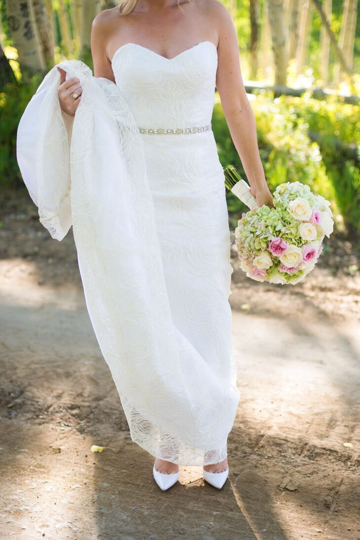 Ashley wore a floral French lace wedding dress with a fluted skirt, double charmeuse under gown and a crystal belt.