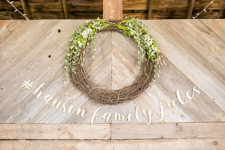 Chic, handcrafted details were used throughout the reception, including wreaths and custom signage that spelled out the couple's wedding hashtag.