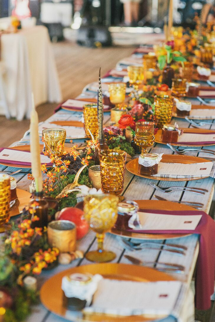 The reception had multiple tablescapes that were designed completely by Amanda Jewel. Tables featured stacked vintage books and medicine bottles filled with pops of blooms.