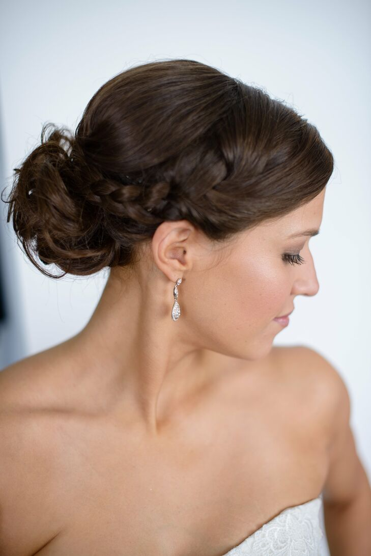 Alison styled her hair in an updo with a side French braid. The beautiful braid added an element of fun while remaining classy and refined. The updo allowed her features to shine and her tear-drop earrings to stand out against her olive skin.