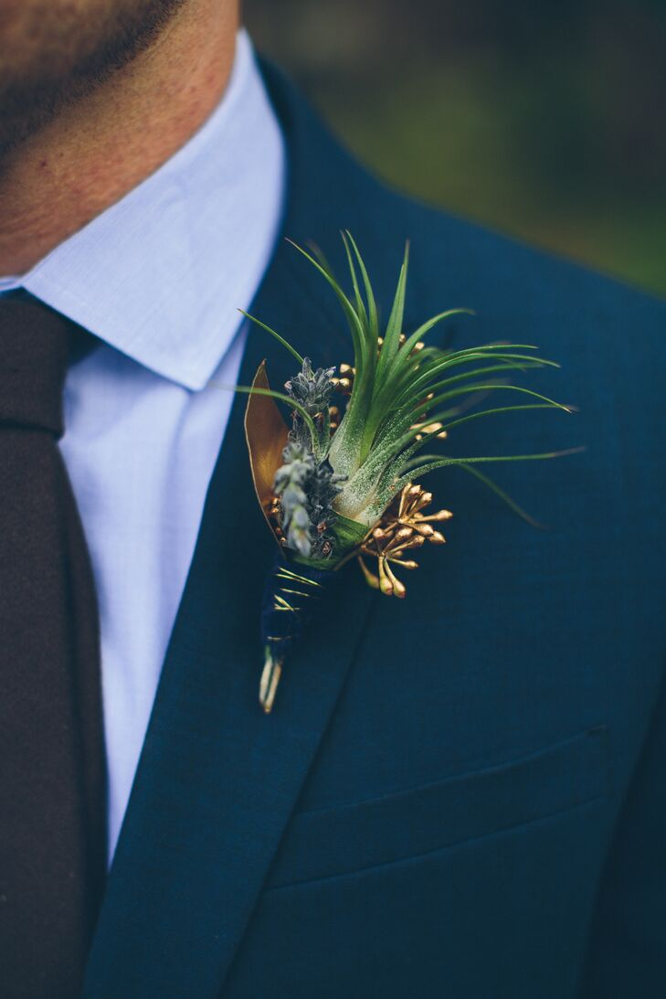 Thistles mixed with plants painted gold made for a unique groom's boutonniere.