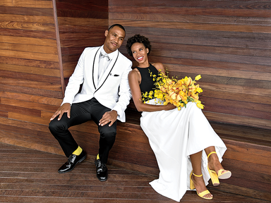 modern black and white wedding attire with yellow bouquet