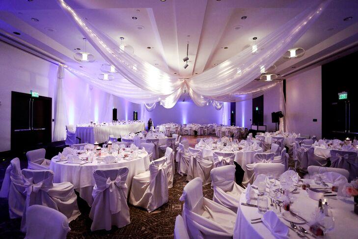 White Drapery Purple Uplighting Wedding Reception