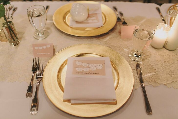 Guests' place settings had gold chargers, and neutral paper goods including menu cards and place cards, topped with the papel picado theme.