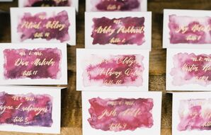 Purple Watercolor Escort Cards with Gold Calligraphy