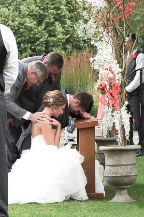 Bride and Groom Praying at Christian Ceremony