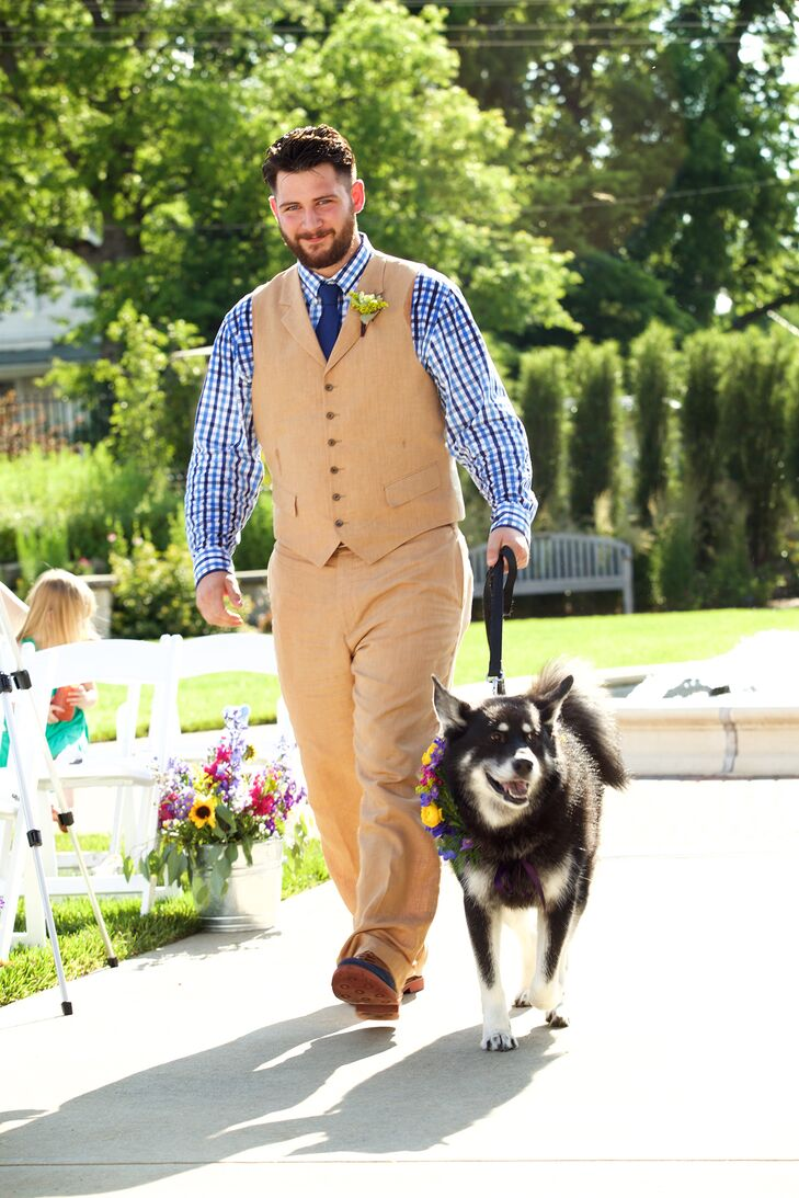 The groomsmen wore khaki linen vests and pants paired with a blue and navy gingham-checkered shirts. They completed their look with a navy tie and lush boutonnieres. Chelcie and Troy were sure to incorporate their favorite furry friends into the day as well. The dog of honor walked down the aisle wearing a flower crown that matched Chelcie's look.