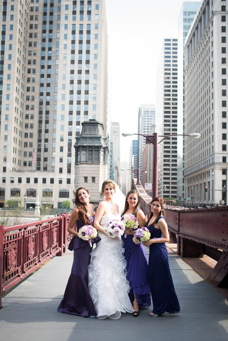 """Since her three bridesmaids live overseas, Fiorella sent them a photo of the style dress she wanted along with the color. """"In the end, the dresses they picked looked perfect,"""" she says of the deep purple, floor-length gowns."""
