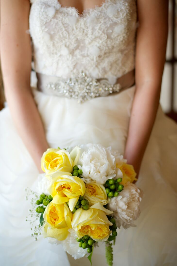 Lauren carried yellow roses, white peonies and green hypericum berries in her natural bouquet.