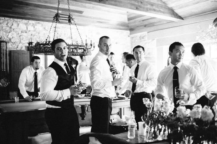 Brittany and Justin designed their entire wedding around a timeless, classic look so Justin wore a fitted black Hugo Boss Tuxedo. His groomsmen matched in equally classy black Jos A Banks tuxedos.