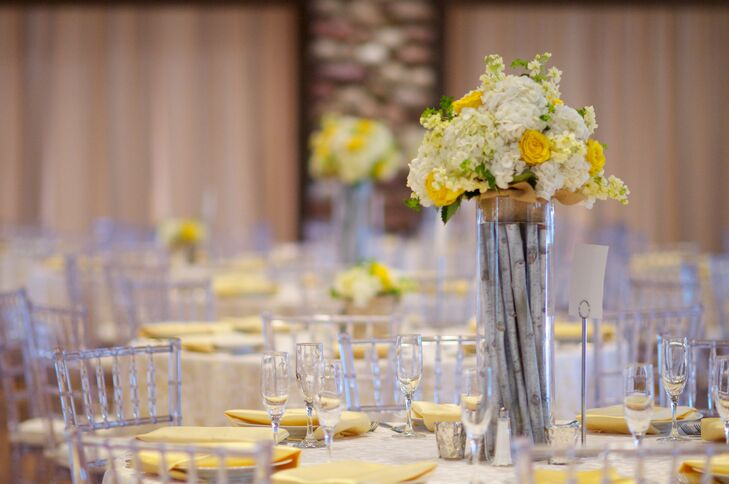 The centerpiece included wood-filled glass vases topped with white hydrangeas and yellow roses.