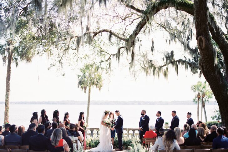 """We had an outdoors morning ceremony in the absolutely gorgeous riverfront garden of the mansion, under 100-year-old oak trees draped in Spanish moss,"" Tammie says."