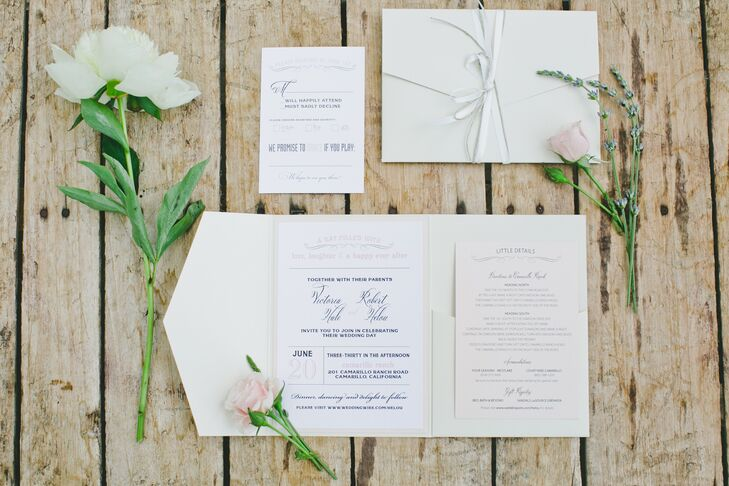 White invitations with charcoal gray and light pink text reflected the day's romantic palette, giving  guests a preview of the charming day to come.