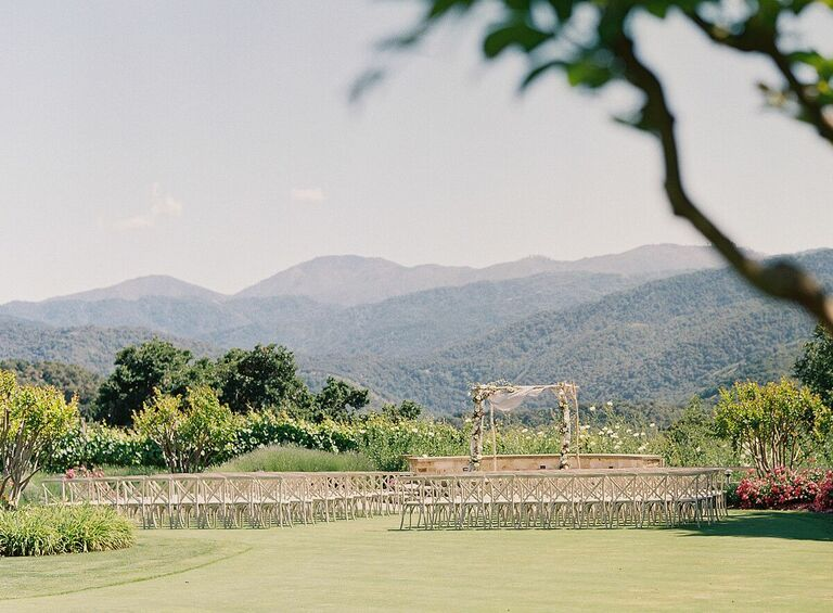 Outdoor wedding ceremony with mountain backdrop