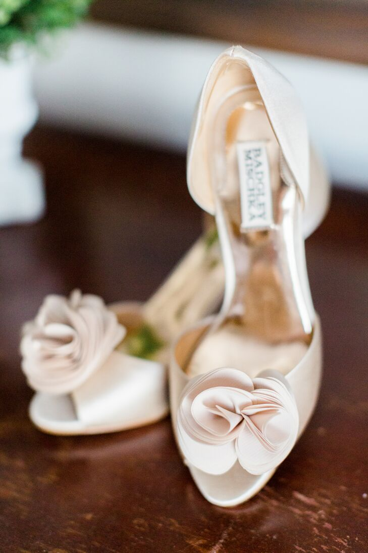 "Nicole wore nude satin heels from Badgley Mischka for her first-look photos, then secretly changed into white Tory Burch flip-flops to wear down the aisle under her long gown. ""I'm not a heels girl,"" she says."