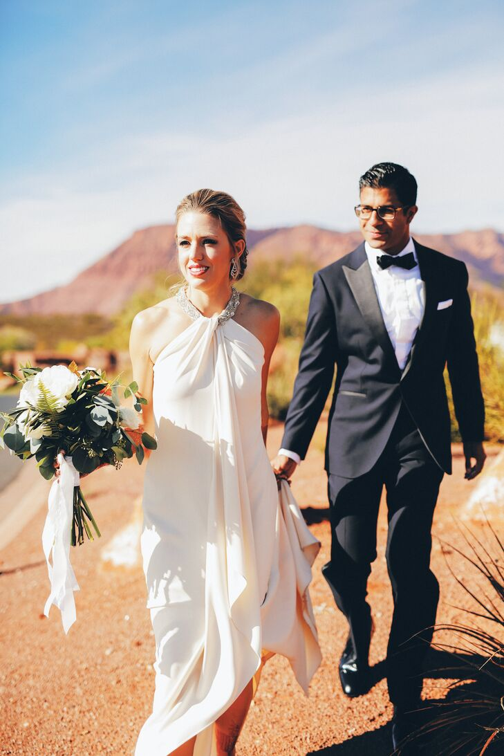 The bride wore a custom Neiman Marcus wedding gown at the reception; the groom wore a blue tuxedo created by Enzo Custom in Washington, DC.
