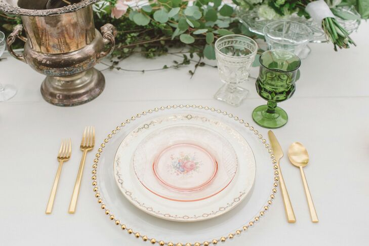 Each setting at the dining table had vintage white floral chinaware, placed on top of glass plates beaded with gold—a combination that created a vintage, elegant look for guests to dine at!