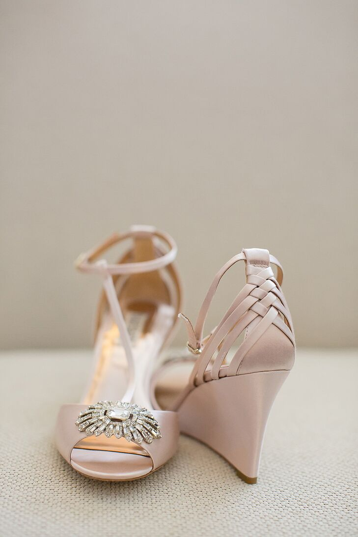 """Mary wore blush Badgley Mischka wedges with jewel and braid detailing. """"Wedding wedges? Who even knew that was a thing. I saw them online, and they were the exact color of the bridesmaid dresses. I was able to dance the whole night without going barefoot."""""""