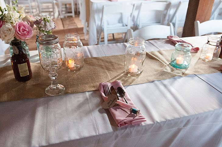 Mary and Sam's long, rectangular dinner tables were lined with burlap table runners and glass mason jars filled with either battery-powered candles or pink and white flowers.