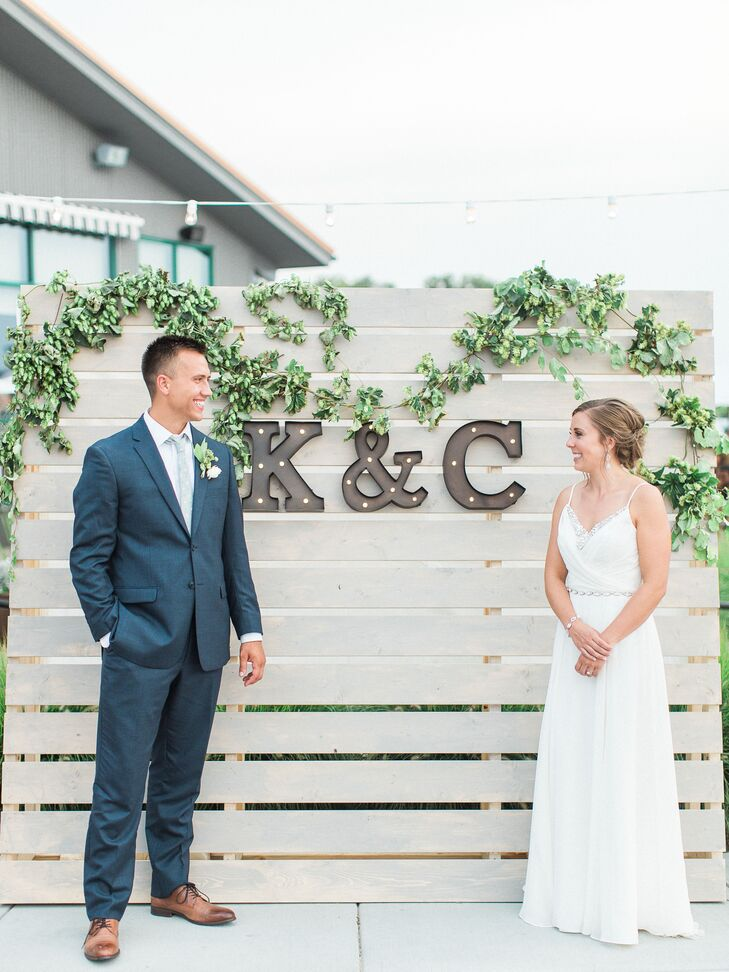 Locally sourced hops and greens covered a wooden pallet wall, which served as a backdrop during the reception.