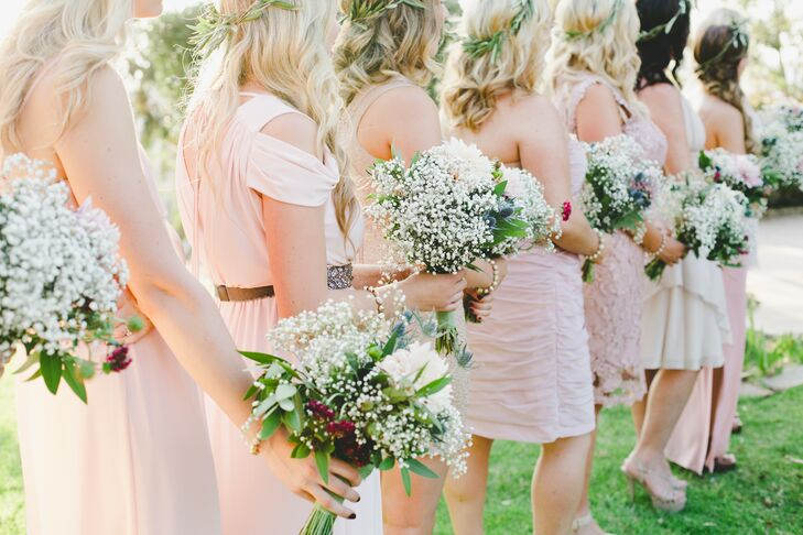Each bridesmaid chose her own dress in a shade of blush. Rosebud Floral Design fashioned flower crowns for each bridesmaid.