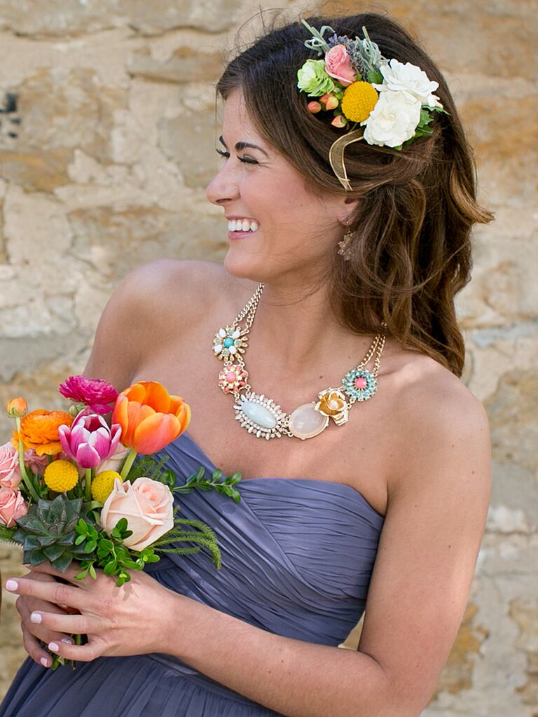 Boho bridesmaid hairstyle with loose waves and fresh flowers