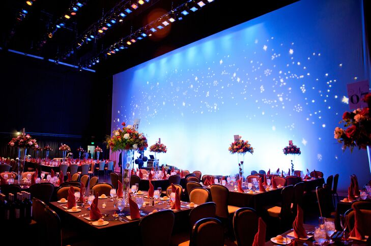Dining tables for the reception were arranged on the Bushnell's stage. The backdrop resembled a starry night, and the area was illuminated with colorful spotlights.