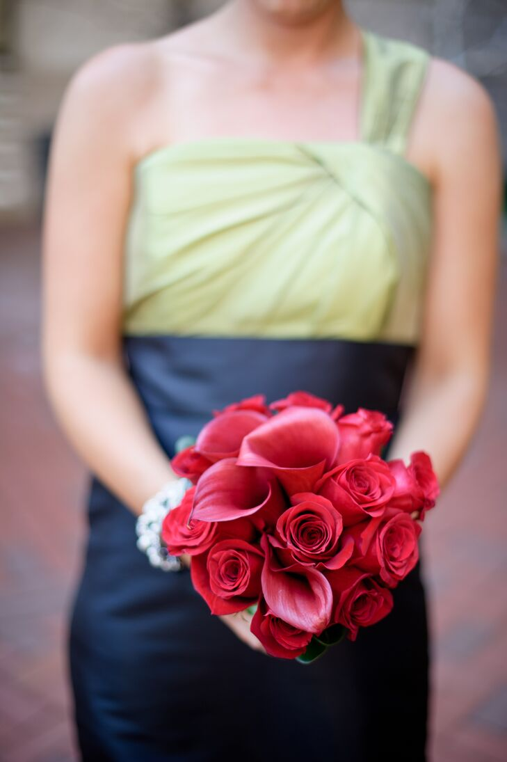 The bridesmaids carried bouquets of red calla lilies and roses with their Alfred Angelo dresses.