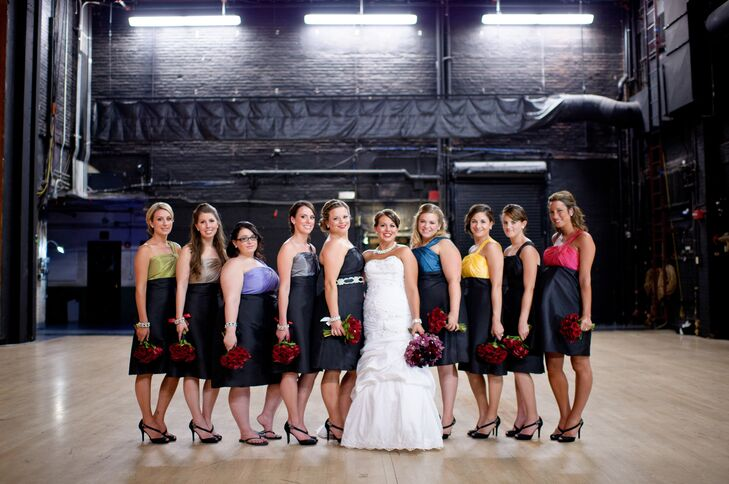 "Nicole's bridesmaids wore black dresses with different-colored bodices by Alfred Angelo. ""I love how they matched and complemented one another,"" Nicole says."
