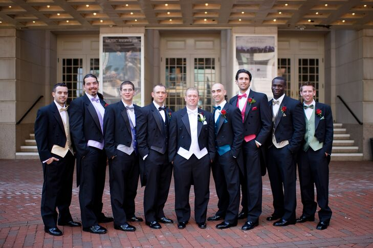The groomsmen wore black tuxedos with different-colored vests and bow ties. Daniel wore a white vest and bow tie with his tuxedo.