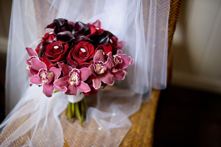 Nicole carried a bouquet with pink orchids, red roses and deep purple calla lilies on her wedding day.