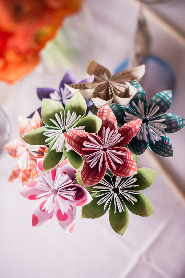 The bride crafted colorful paper flowers and set them in popcorn boxes as table centerpieces.