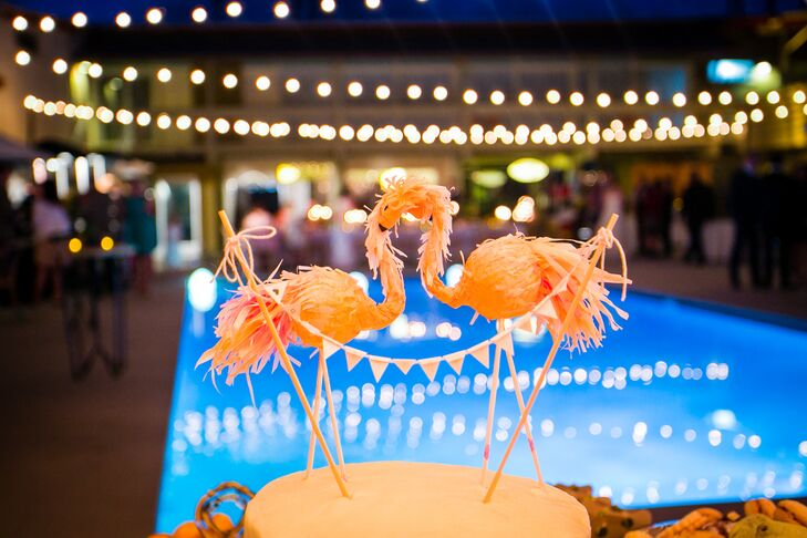 The bride made the bride and groom's pink flamingo cake topper herself after seeing something similar online. The pink flamingos played up the retro Palm Springs decor and brought in the pink of their funky color palette.