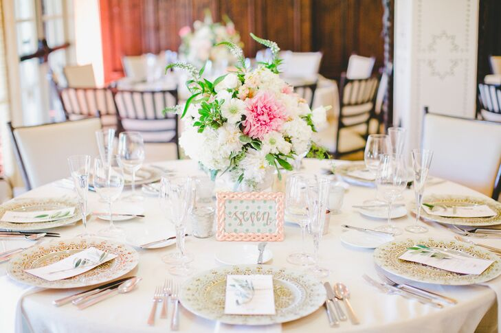 For the centerpieces, the couple's florist Michelle Jacob created textured, yet refined arrangements of scabiosas, hydrangeas, dahlias, stock flowers and Veronicas in shades of ivory and white, with pops of bright pink and peach.