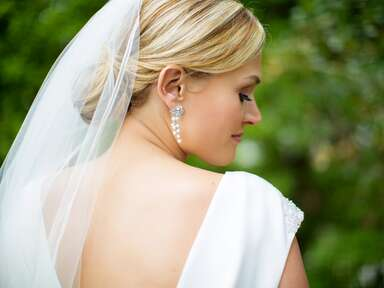 Bride with an updo and simple veil
