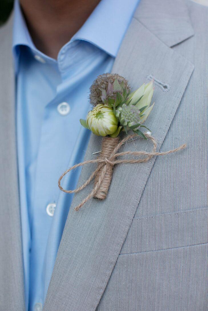 A dahlia bud, scabiosa pod and burlap string created a masculine boutonniere.