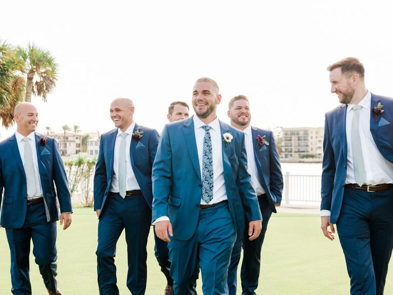 Groom and groomsmen walking to wedding ceremony