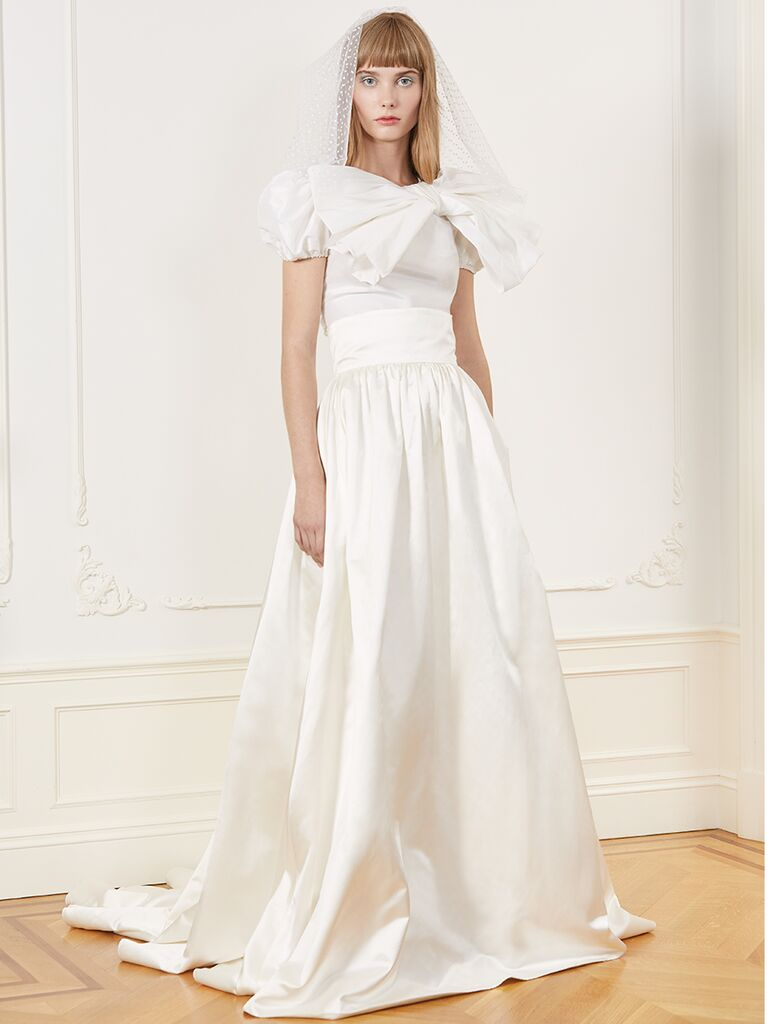 Honor ballgown with cap sleeves, bow detail and banded skirt