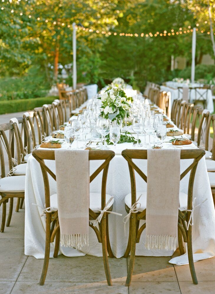 Champagne-colored Pashminas were draped over the chairs of each female guest to keep them comfortable and warm throughout the evening.