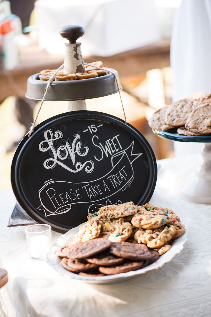 """Their cookie bar was a community effort and couldn't have been sweeter. Family members and friends made chocolate chip, M&M's and other cookie flavors that filled tiers upon tiers at the reception in DeLand, Florida. Guests were also welcome to take a few home in custom paper bags that read """"We go together like cookies and milk."""""""