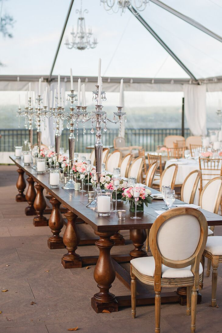 The decadent head table, which consisted of rustic French furniture, was set with romantic silver candelabras.