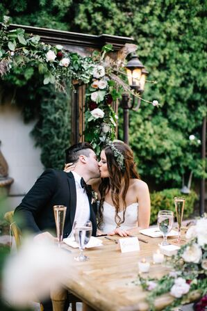 Bride and Groom Kissing at Outdoor Garden Reception