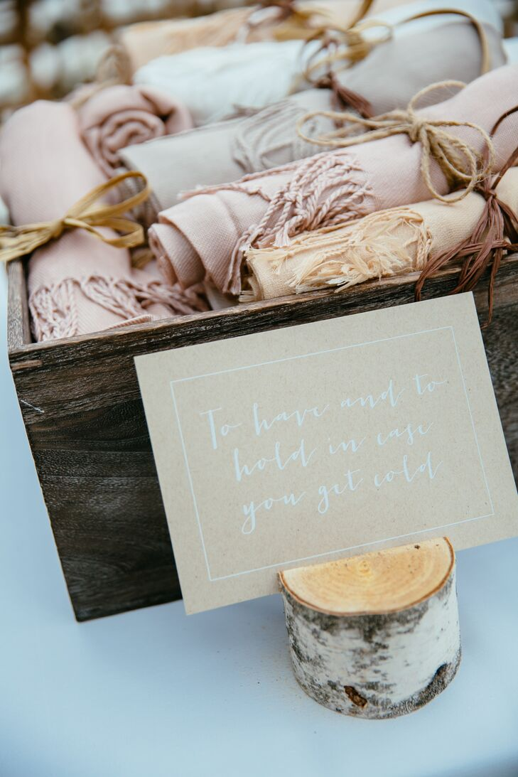 """Keeping their theme in mind, Jenna and Mike even added organic details into the mix. A wooden box filled with neutral, blush and peach pashminas was waiting for guests during the outdoor ceremony. A birch wood stand even held up the sign with a cute """"to have and to hold"""" pun."""