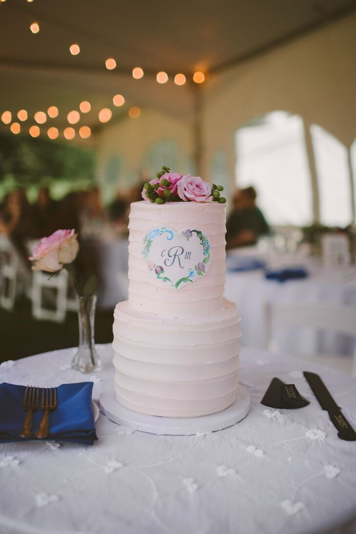 For dessert, Mary and Chris served a rainbow cake covered in textured buttercream frosting. The cake was topped by fresh roses and featured Mary and Chris's rosemaling-patterned crest.