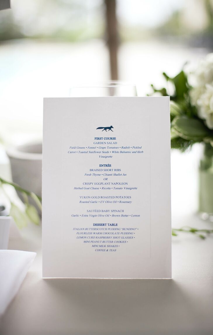 """The couple's menu also featured their fox motif. Each DIY white card carried on their navy and white colors with a whimsical circular design. One detail that was left off the menu, however, was the surprise late-night treat. """"Our late-night snacks were mini Philly pretzels, mini mac and cheese and mini grilled cheeses,"""" Cam says. """"They were a huge hit."""""""