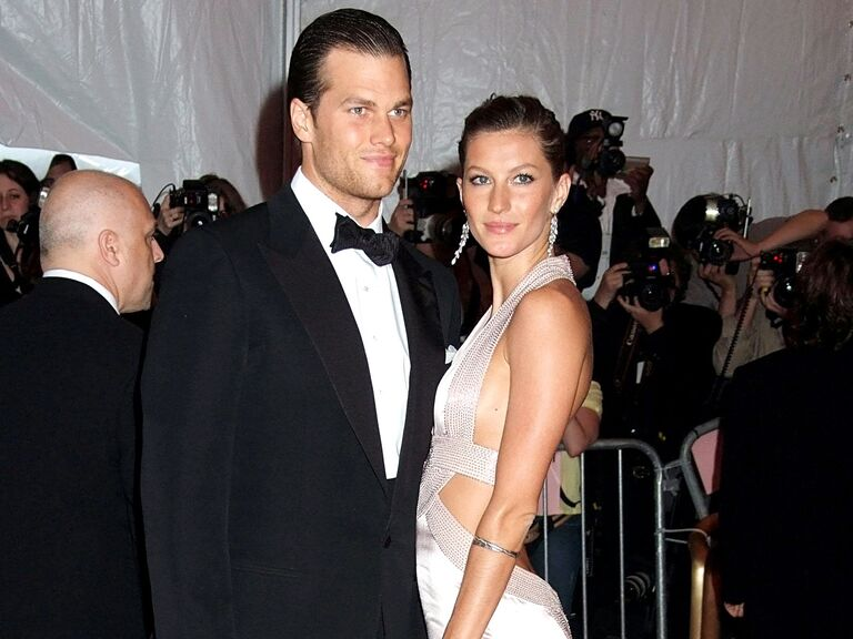 Gisele Bundchen and Tom Brady pose together at an event