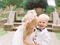 Flower girl and ring bearer dressed in formalwear