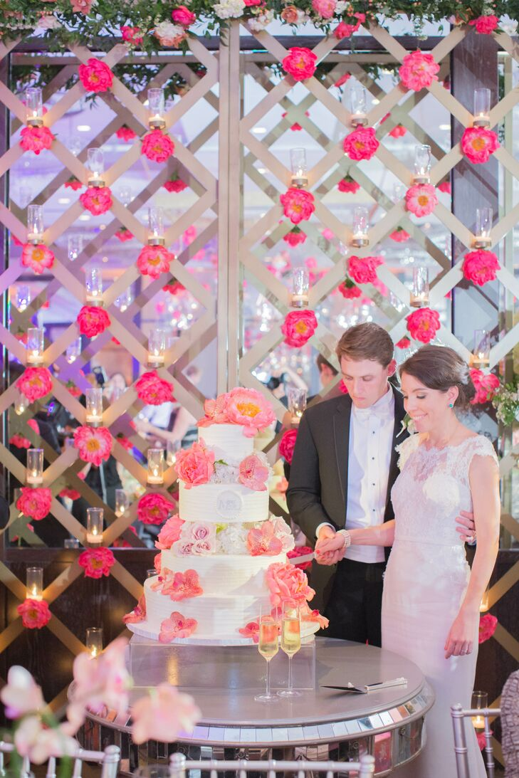 A decorated arbor served as a memorable cake backdrop.